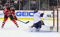 Feb 9; Newark, NJ, USA; New Jersey Devils center Patrik Elias (26) scores a goal on St. Louis Blues goalie Jaroslav Halak (41) during the second period at the Prudential Center.