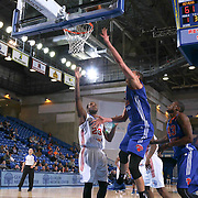 Westchester Knicks Center Ben Strong (8) drives towards the basket as Delaware 87ers Forward Victor Rudd (23) defends in the second half of a NBA D-league regular season basketball game between the Delaware 87ers and the Westchester Knicks (New York Knicks) Wednesday, Feb. 17, 2015 at The Bob Carpenter Sports Convocation Center in Newark, DEL