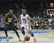 Ole Miss' LaDarius White (10) vs. La Salle's Ramon Galloway (55) in the Round of 32 of the NCAA Tournament at the Sprint Center in Kansas City, Mo. on Sunday, March 24, 2013. La Salle won 76-74.