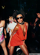 Woman pouting at the camera wearing a revealing red dress, Ibiza, 2000