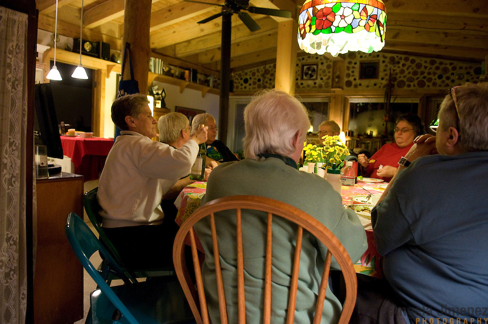 "Date: 1/08/09.Desk: STL.Slug: WOMYN.Assign ID: 30074969A..Women gather for a potluck dinner at Alapine, a ""womyn's land"" or lesbian intentional community, in rural northeast Alabama, at the home of one of the community's residents. ..(*the exact town/location of the community cannot be revealed in the caption or article, per agreement with the subjects)..Photo by Angela Jimenez for The New York Times .photographer contact 917-586-0916"