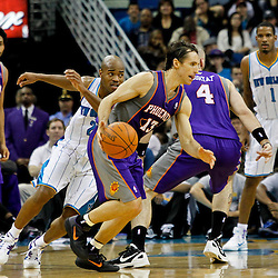February 2, 2012; New Orleans, LA, USA; Phoenix Suns point guard Steve Nash (13) drives past New Orleans Hornets point guard Jarrett Jack (2) during the second quarter of a game at the New Orleans Arena.   Mandatory Credit: Derick E. Hingle-US PRESSWIRE