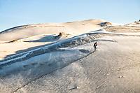 Man walking on the dunes of Ribanceira Beach. Imbituba, Santa Catarina, Brazil. / <br /> Homem caminhando nas dunas da Praia da Ribanceira. Imbituba, Santa Catarina, Brasil.