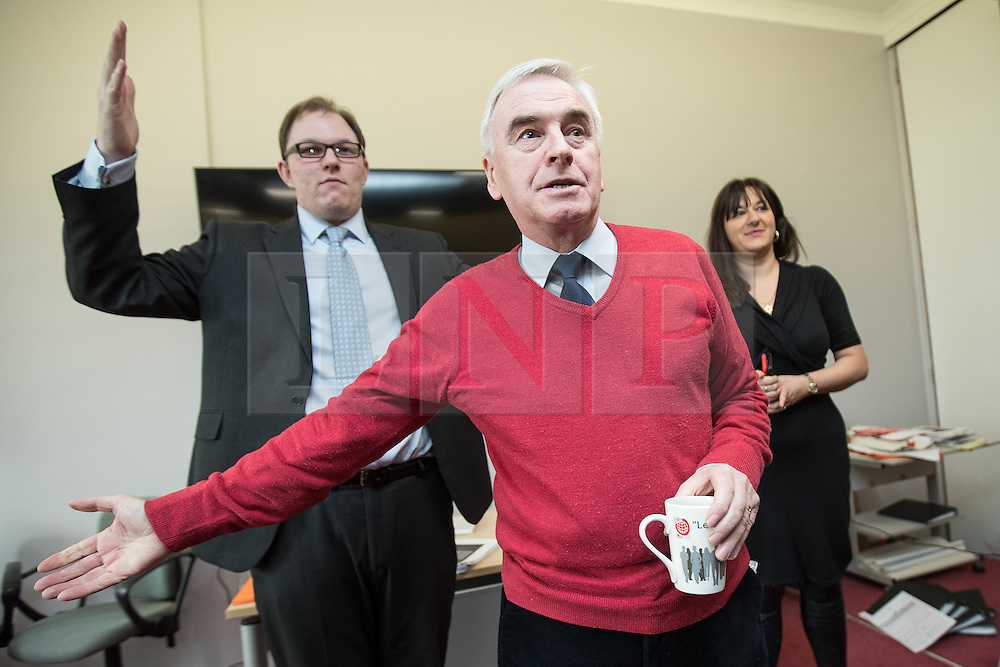 © Licensed to London News Pictures . 19/02/2017. Stoke-on-Trent, UK. Labour Shadow Chancellor JOHN MCDONNELL (c) joins GARETH SNELL (l) - the party's candidate for the seat of Stoke-on-Trent Central - and LUCIANA BERGER MP , at the Labour Party campaign base on Garth Street in Stoke , with party campaigners , in the final week of the by-election campaign . Photo credit: Joel Goodman/LNP