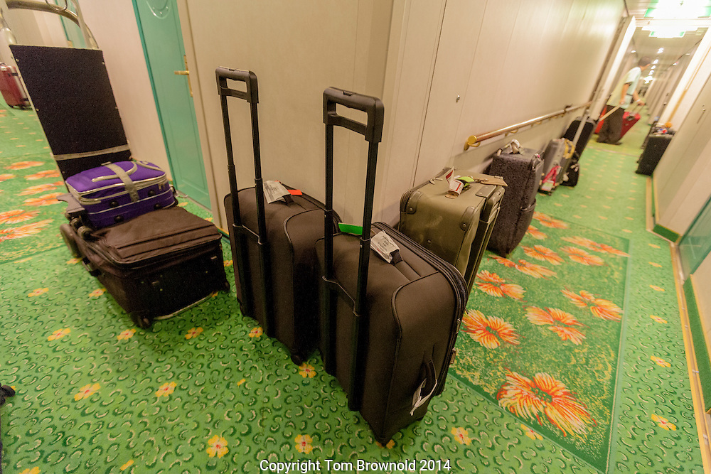 Passengers luggage awaiting delivery to the proper cabin, on board ship.