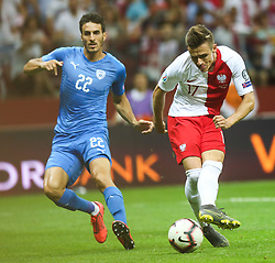 June 10, 2019 - Warsaw, Poland - Damian Kadzior of Poland and Hatem Elhamed (ISR) during the UEFA Euro 2020 qualifier Group G football match Poland against Israel on June 10, 2019 in Warsaw, Poland. (Credit Image: © Foto Olimpik/NurPhoto via ZUMA Press)