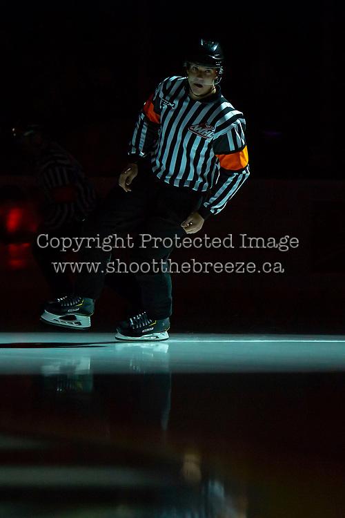KELOWNA, BC - OCTOBER 12: Referee Tyler Adair skates onto the ice at the Kelowna Rockets against the Kamloops Blazers at Prospera Place on October 12, 2019 in Kelowna, Canada. (Photo by Marissa Baecker/Shoot the Breeze)