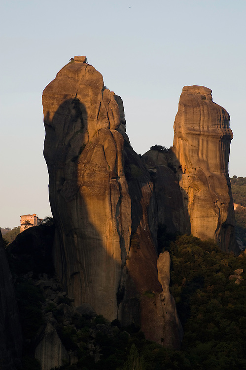Greece, Meteora, cliff in sunset,  Roussanou Monastery in backgroung
