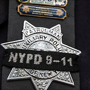 NYPD police officer the wearing of the mourning band.<br /> <br /> The mourning band is very symbolic in law enforcement and should be worn with great respect and under department guidelines.