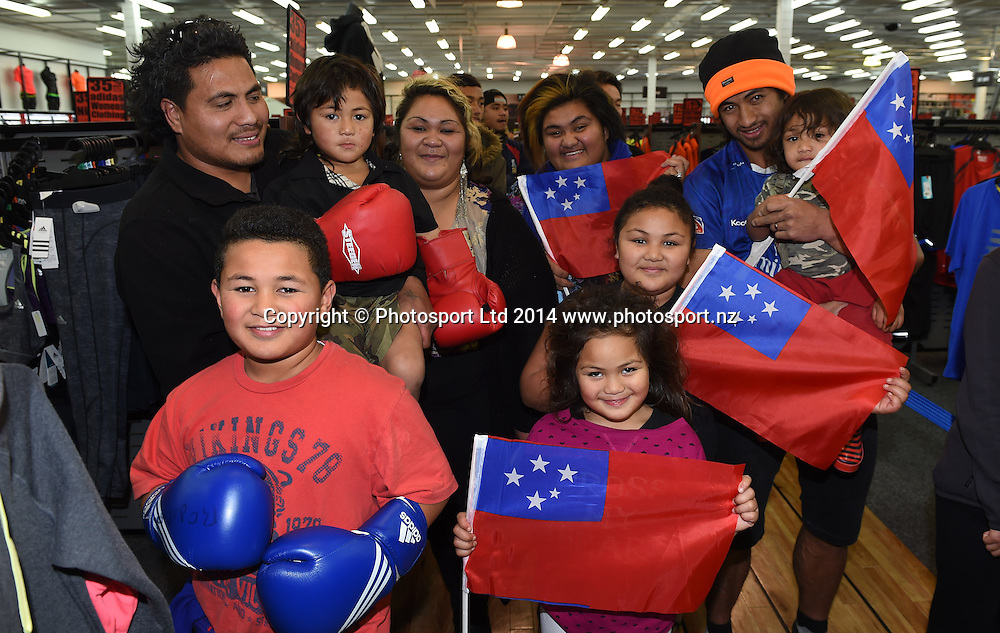 Fans from the Samoan community wait in line to meet Boxer Joseph Parker during a signing session at Rebel Sport Manukau for sponsor Under Armour ahead of the Parker v Minto Hydr8 Zero Heavyweight Explosion fight scheduled for 5 July 2014. Auckland. Saturday 28 June 2014. Photo: Andrew Cornaga/www.photosport.co.nz