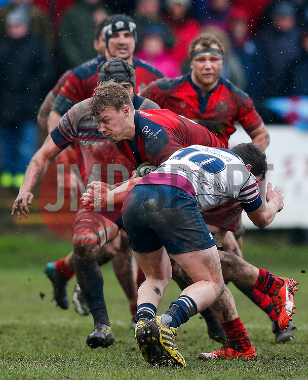 Bristol Rugby Number 8 Mitch Eadie is tackled by Rotherham Titans Fly-Half Ross Jones - Mandatory byline: Rogan Thomson/JMP - 06/02/2016 - RUGBY UNION - Clifton Lane - Rotherham, England - Rotherham Titans v Bristol Rugby - Greene King IPA Championship.