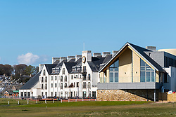 View of Carnoustie Golf Course Hotel behind 18th Green at Carnoustie Golf Links in Carnoustie, Angus, Scotland, UK. Carnoustie is venue for the 147th Open Championship in 2018. New club house opened in April 2018 on the right.
