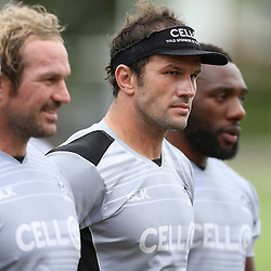 DURBAN, SOUTH AFRICA - Jannie Du Plessis with Bismarck Du Plessis (captain) of the Cell C Sharks and Tendai Beast Mtawarira during the Cell C Sharks training session at Growthpoint Kings Par in Durban, South Africa. (Photo by Steve Haag)