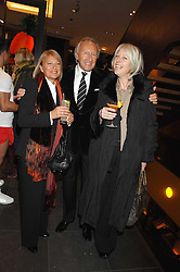 Left to right, MR & MRS HAROLD TILLMAN and HILARY RIVA Chief Executive of the British Fashion Council at a party hosted by Mulberry to celebrate the publication of The Meaning of Sunglasses by Hadley Freeman held at Mulberry 41-42 New Bond Street, London on 14th February 2008.<br />