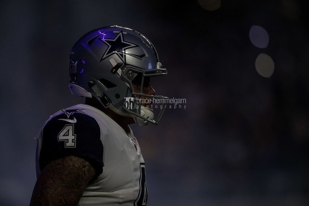Dec 1, 2016; Minneapolis, MN, USA; Dallas Cowboys quarterback Dak Prescott (4) looks on prior to the game between the Dallas Cowboys and Minnesota Vikings at U.S. Bank Stadium. The Cowboys defeated the Vikings 17-15. Mandatory Credit: Brace Hemmelgarn-USA TODAY Sports