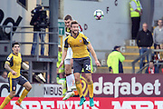 Arsenal defender Shkodran Mustafi (20) heads clear during the Premier League match between Burnley and Arsenal at Turf Moor, Burnley, England on 2 October 2016. Photo by Pete Burns.
