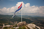 Ancient Serbian fortress on Zvecan hill. A wind-torn Serbian flag...Border crisis, July 2011