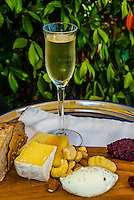 "Local cheese platter accompanied by Pierre Jordan Ratafia wine, the last of a six course ""Taste of Summer"" lunch menu, restaurant at Haute Cabriere Vineyard Estate, Franschhoek Pass, Franschhoek, Cape Winelands, South Africa."