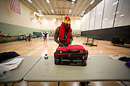 Nathan Vain packs his belongings in a suitcase backstage during Championship Wrestling Entertainment's Live Pro Wrestling event at the Port St. Lucie Civic Center on Friday, May 15, 2015. (XAVIER MASCAREÑAS/TREASURE COAST NEWSPAPERS)