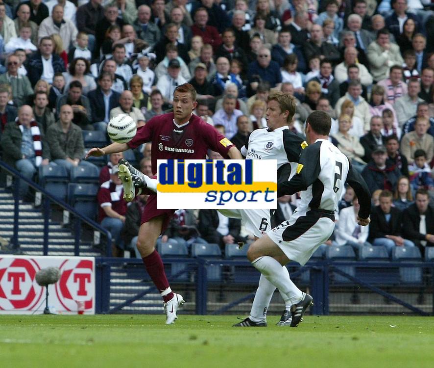 Photo: Andrew Unwin.<br /> Hearts v Gretna. Tennants Scottish Cup Final. 13/05/2006.<br /> Gretna's John O'Neil (C) looks to tackle Hearts' Roman Bednar (L).