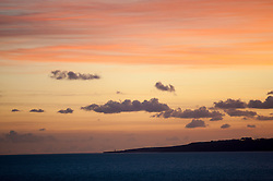 Portland on the horizon at sunset, viewed from Durdle Door, Dorset, England, UK.