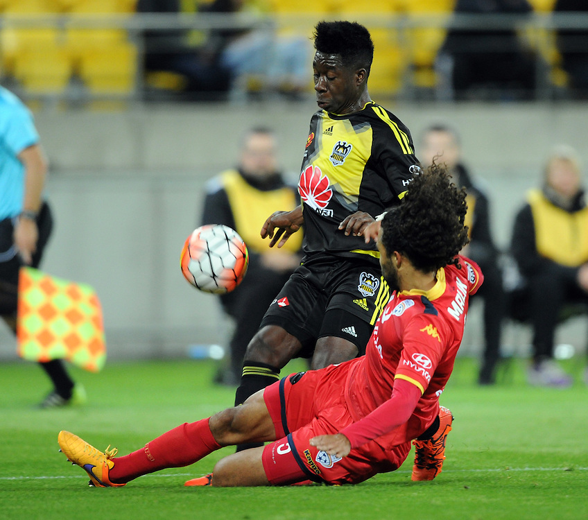 Adelaide United's Osama Malik tackles Phoenix's Jeffery Sarpong in the A-League football match at Westpac Stadium, Wellington, New Zealand, Friday, November 13, 2015. Credit:SNPA / Ross Setford