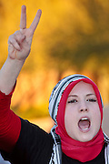 30 DECEMBER 2008 -- PHOENIX, AZ: HUDA SHROUROU, a Palestinian from Tempe, AZ, chants in favor of Palestinian rights at a pro-Palestinian protest in Phoenix, AZ, Tuesday. About 200 people from a variety of human rights and peace activists organizations in Phoenix, AZ, marched in opposition to the Israeli attacks on Gaza and in favor of Palestinian rights on Tuesday, the fourth day of Israeli air strikes on Hamas facilities in Gaza. Photo by Jack Kurtz / ZUMA Press