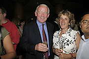 Col Paul Belcher ( guards club chairman) and Mrs. Belcher. Cartier Polo Players Party, The Collection, 264 Brompton Road, London, SW3, 25 July 2006. ONE TIME USE ONLY - DO NOT ARCHIVE  © Copyright Photograph by Dafydd Jones 66 Stockwell Park Rd. London SW9 0DA Tel 020 7733 0108 www.dafjones.com