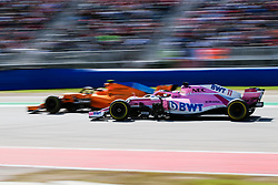 October 21, 2018 - Austin, TX, U.S. - AUSTIN, TX - OCTOBER 21: McClaren driver Fernando Alonso (14) of Spain leads Force India driver Sergio Perez (11) of Mexico towards turn 16 during the F1 United States Grand Prix on October 21, 2018, at Circuit of the Americas in Austin, TX. (Photo by John Crouch/Icon Sportswire) (Credit Image: © John Crouch/Icon SMI via ZUMA Press)