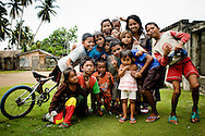 Philippines, Tawi Tawi. Group of Filipino children posing with their bicycle.