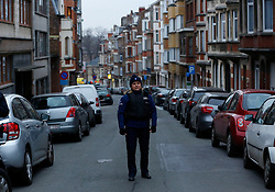 Police officers guard at a crossroad on the site of a shooting in Forest, Brussels, Belgium, March 15, 2016. A police officer was injured on Tuesday afternoon in a shootout during a raid on a property in Brussels, reportedly linked to the Paris terror attacks. EXPA Pictures © 2016, PhotoCredit: EXPA/ Photoshot/ Ye Pingfan<br /> <br /> *****ATTENTION - for AUT, SLO, CRO, SRB, BIH, MAZ, SUI only*****
