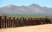 The vehicle barrier on the U.S. - Mexico border is seen crossing through the Tohono O'odham reservation in Chukut Kuk, Arizona April 6, 2017. Picture taken April 6, 2017.  REUTERS/Rick Wilking