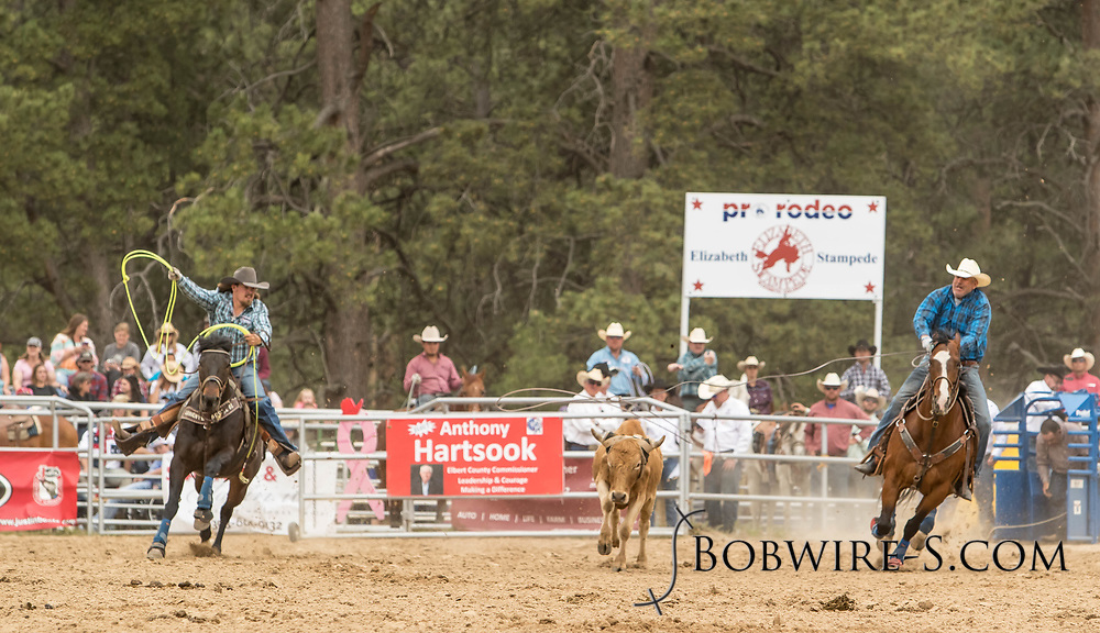 Header XXX and heeler XXX make their team roping run during the third performance of the Elizabeth Stampede on Sunday, June 3, 2018.