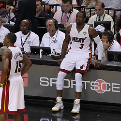 Jun 21, 2012; Miami, FL, USA; Miami Heat shooting guard Dwyane Wade (3) sits on the score table during the third quarter in game five in the 2012 NBA Finals against the Oklahoma City Thunder at the American Airlines Arena. Mandatory Credit: Derick E. Hingle-US PRESSWIRE