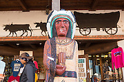 Indian Trading Post with carved wooden Indian Chief sculpture in the Old Town Plaza December 14, 2015 in Albuquerque, New Mexico.
