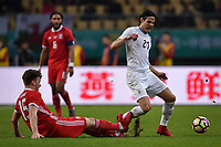 """Edinson Cavani, right, of Uruguay national football team kicks the ball to make a pass against a player of Wales national football team in their final match during the 2018 Gree China Cup International Football Championship in Nanning city, south China's Guangxi Zhuang Autonomous Region, 26 March 2018.<br /> <br /> Edinson Cavani's goal in the second half helped Uruguay beat Wales to claim the title of the second edition of China Cup International Football Championship here on Monday (26 March 2018). """"It was a tough match. I'm very satisfied with the result and I think that we can even get better if we didn't suffer from jet lag or injuries. I think the result was very satisfactory,"""" said Uruguay coach Oscar Tabarez. Wales were buoyed by a 6-0 victory over China while Uruguay were fresh from a 2-0 win over the Czech Republic. Uruguay almost took a dream start just 3 minutes into the game as Luis Suarez's shot on Nahitan Nandez cross smacked the upright. Uruguay were dealt a blow on 8 minutes when Jose Gimenez was injured in a challenge and was replaced by Sebastian Coates. Inter Milan's midfielder Matias Vecino of Uruguay also fired at the edge of box from a looped pass but only saw his attempt whistle past the post. Suarez squandered a golden opportunity on 32 minutes when Ashley Williams's wayward backpass sent him clear, but the Barca hitman rattled the woodwork again with goalkeeper Wayne Hennessey well beaten."""