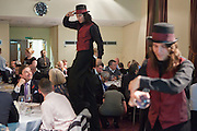 The stilt walker and Juggler perform during dinner in the Forum at the Spark 2010 Pitching Event. Highpoint Conference Centre, Leicester.