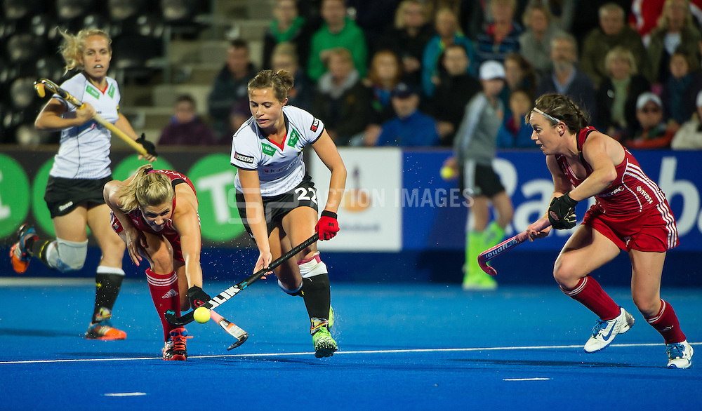 Germany's Lea Stockel is tackled by Georgie Twigg of England. England v Germany - Unibet EuroHockey Championships, Lee Valley Hockey & Tennis Centre, London, UK on 26 August 2015. Photo: Simon Parker