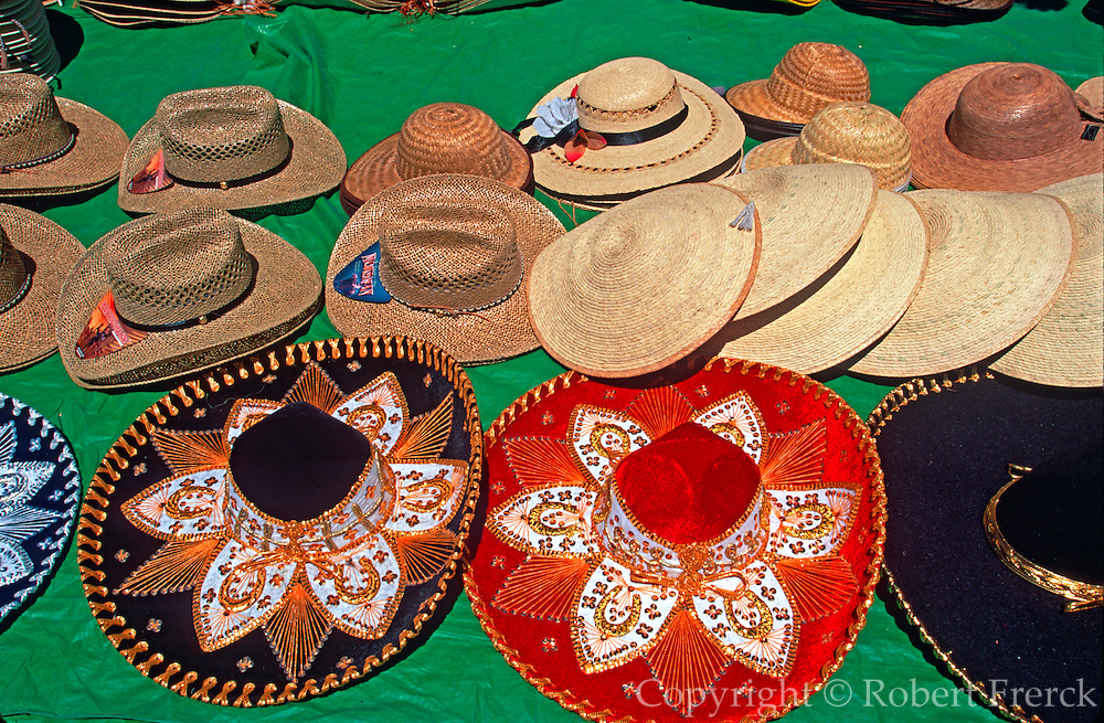 MEXICO, MEXICO CITY, ZOCALO selling hats in market near Cathedral