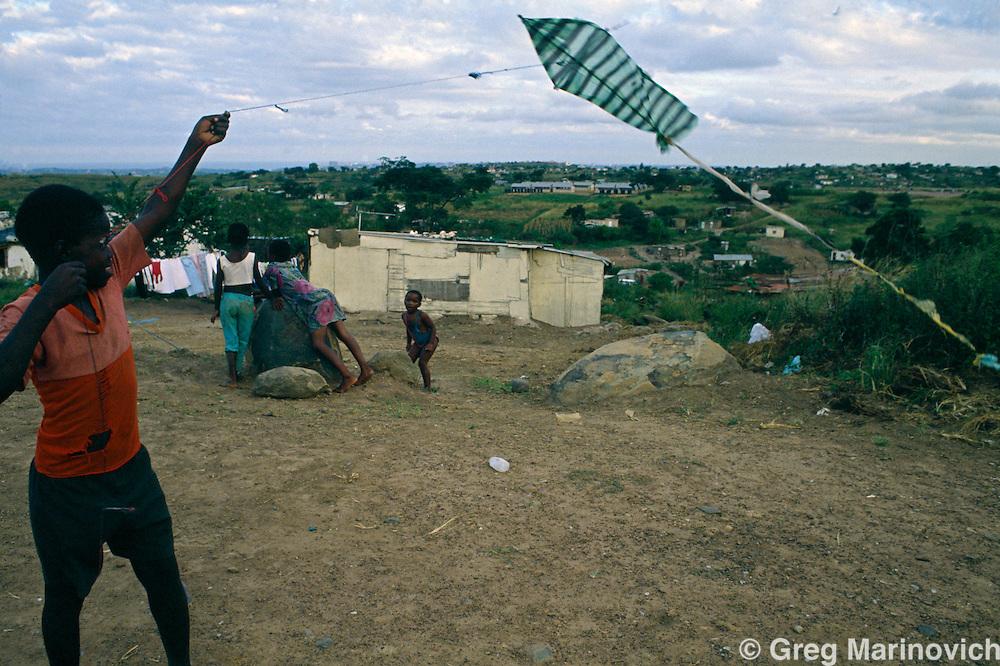 Children fly a kite in KwaMashu KwaZulu Natal, South Africa, 1994.