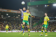 Sheffield Wednesday forward Steven Fletcher (9) and Norwich City midfielder Moritz Leitner (10)  challenge for a header during the EFL Sky Bet Championship match between Norwich City and Sheffield Wednesday at Carrow Road, Norwich, England on 19 April 2019.