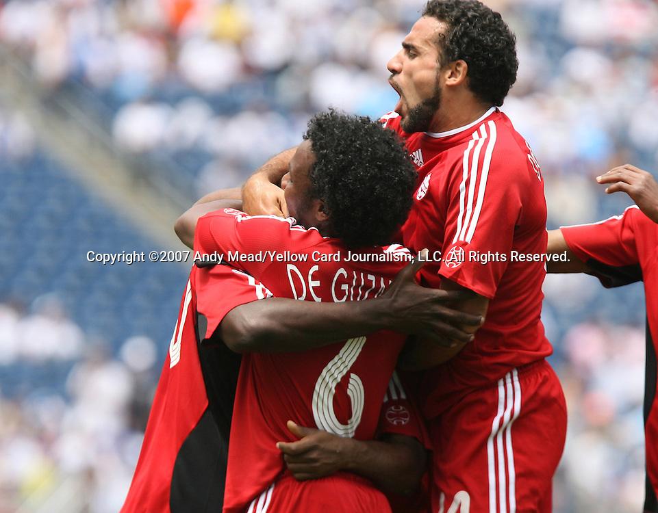 16 June 2007: Canada's Dwayne DeRosario (r) celebrates his goal with teammates Julian DeGuzman(6) and Ali Gerba (l). The Canada Men's National team defeated the Guatemala Men's National Team 3-0 at Gillette Stadium in Foxboro, Massachusetts in a 2007 CONCACAF Gold Cup quarterfinal.