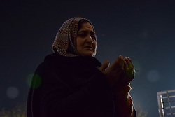 November 21, 2018 - Srinagar, Jammu & Kashmir, India - Kashmiri Muslim woman seen beseeching for blessing at a shrine in Srinagar on the eve of Eid-e-Milad-un-Nab, the birth anniversary of Prophet Muhammad PBUH..Thousands of Kashmiri Muslims were gathered at the shrine in the summer capital of Jammu and Kashmir to offer prayers on the Prophet's birth anniversary. (Credit Image: © Idrees Abbas/SOPA Images via ZUMA Wire)