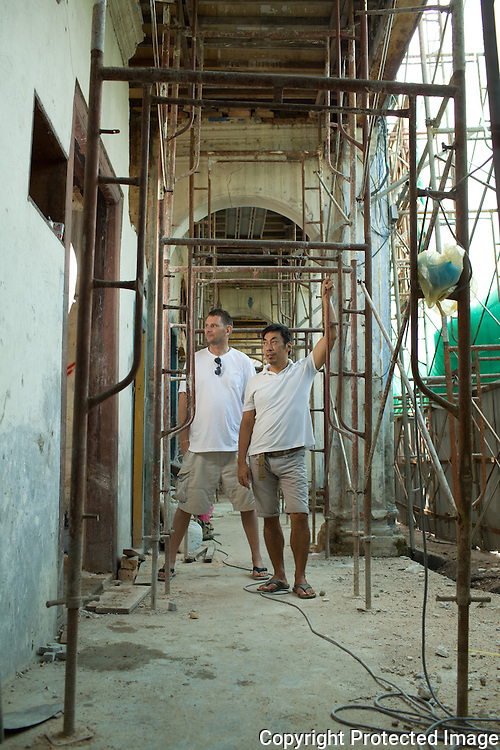 Karl Steinberg (L) and Chris Ong are restoring seven burned out terrace houses on Stewart Lane, with plans to open them as a boutique hotel next year.
