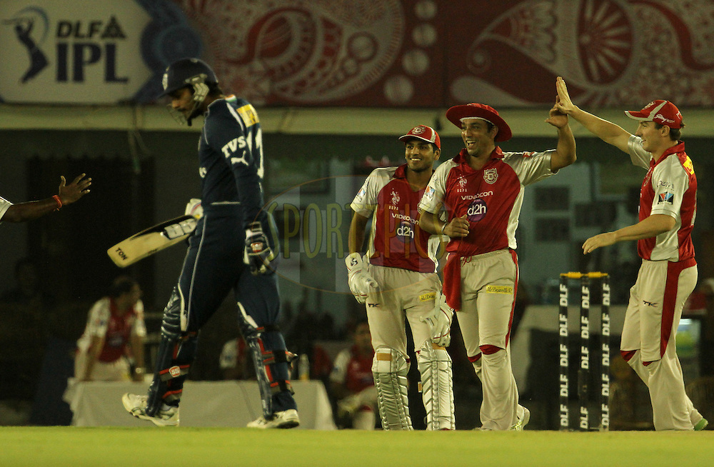 Kings XI Punjab player Azar Mahmood celebrates after taking a catch during match 61 of the Indian Premier League ( IPL) 2012  between The Kings X1 Punjab and The Deccan Chargers held at the Punjab Cricket Association Stadium, Mohali on the13th May 2012..Photo by Vipin Pawar/IPL/SPORTZPICS