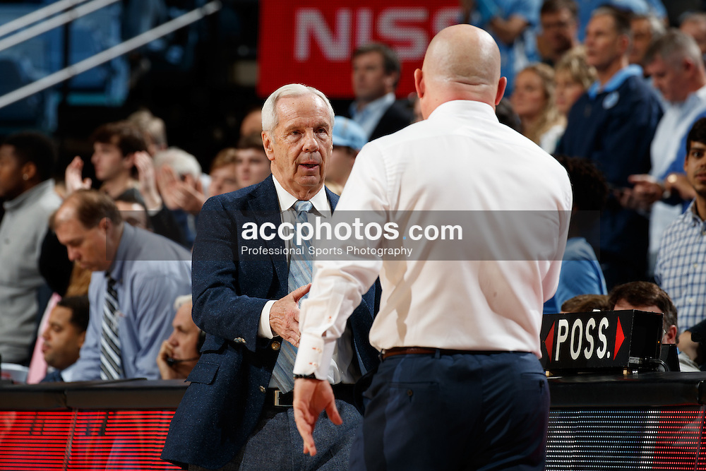 CHAPEL HILL, NC - JANUARY 26: Head coach Roy Williams of the North Carolina Tar Heels meets head coach Buzz Williams of the Virginia Tech Hokies on January 26, 2017 at the Dean Smith Center in Chapel Hill, North Carolina. North Carolina won 91-72. (Photo by Peyton Williams/UNC/Getty Images) *** Local Caption *** Roy Williams;Buzz Williams