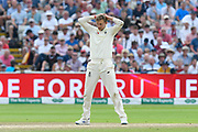 Joe Root of England has his hand on his head after bowling a delivery during the International Test Match 2019 match between England and Australia at Edgbaston, Birmingham, United Kingdom on 3 August 2019.