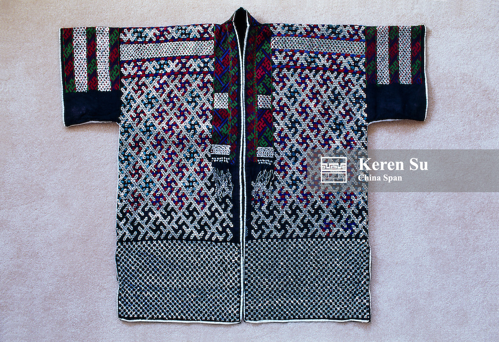 Miao people's costume deoorated by embroidery and metal sequins, China