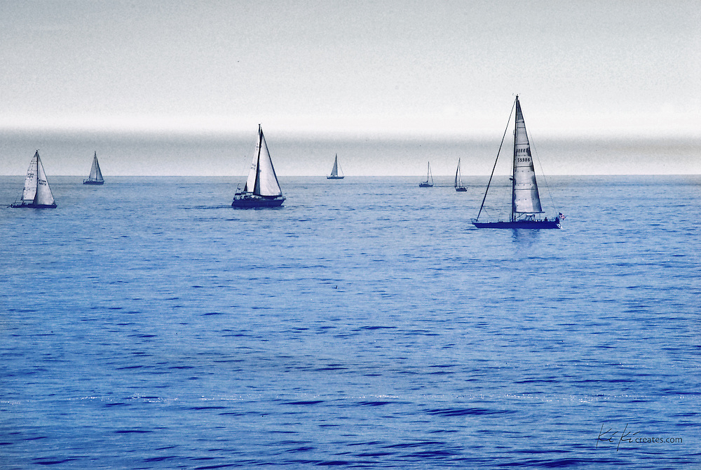 View of the Sailboats swiftly floating by right at dusk in Venice Beach.