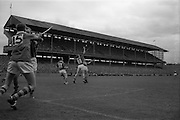 06/09/1964<br /> 09/06/1964<br /> 6 September 1964<br /> All-Ireland Senior Final: Tipperary v Kilkenny at Croke Park, Dublin.<br /> Kilkenny golie, O. Walsh, awaits the outcome of a frantic effort from P. Dillon (Kilkenny full back) and J. McKenna (Tipperary forward) as S. McLoughlin (Tipperary forward) is well matched on the left by C. Whelan.